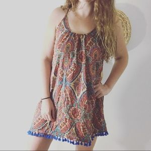Umgee • Tassel Trim Cross Back Mini Dress